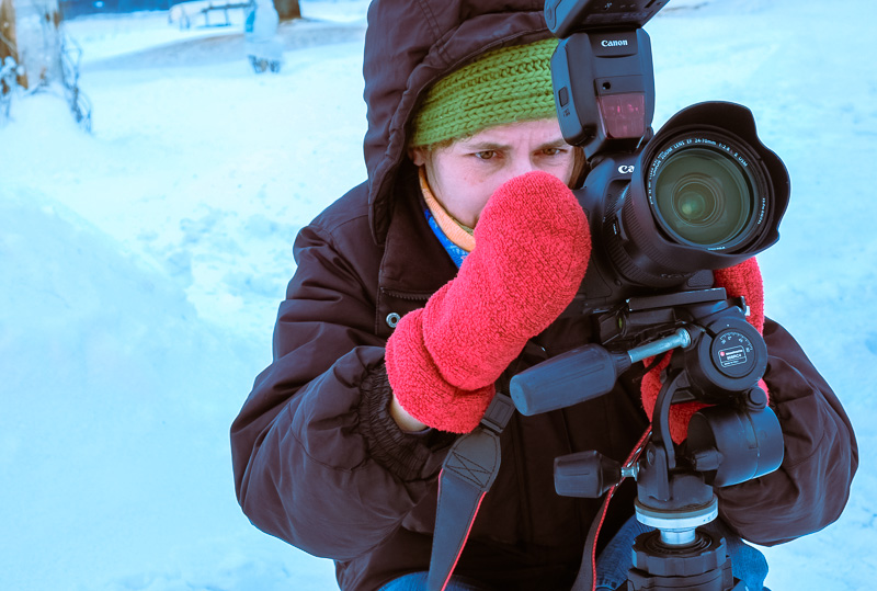 Photographer taking a picture outside in winter
