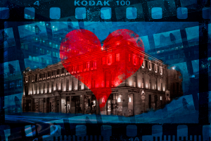 Heart superimposed over a building with photo negative