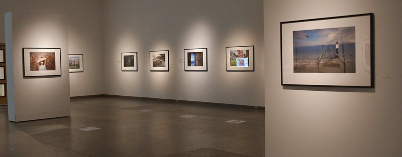 view of an exhibition hall with photographs on the wall