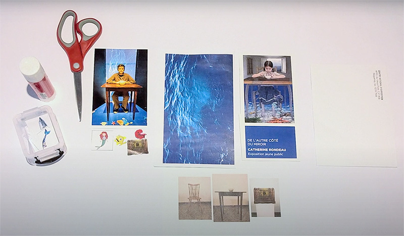 Scissors and various photos are scattered on a work space