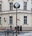 clock lantern on a street corner