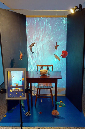 a photo booth with an underwater setting